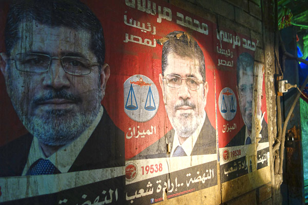 Posters of President Muhammad Morsi decorate homes and shops of people who support the ruling Freedom and Justice Party (with very close ties to the Muslim Brotherhood).