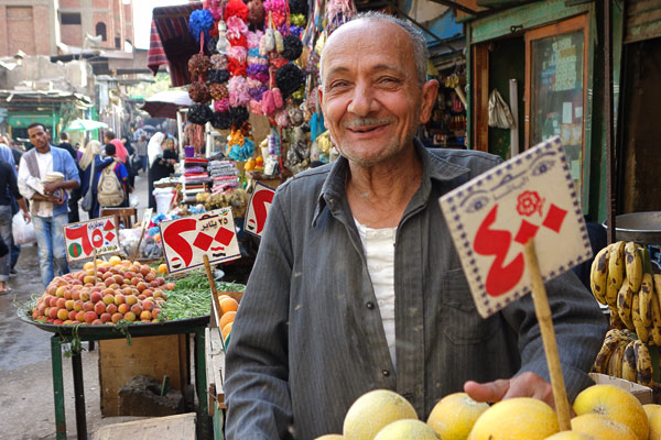 In the market, you need to know the local numbers. This kind man will sell you a kilo of this for 4 Egyptian pounds, a kilo of that for 2 pounds, and a kilo of the other for just 65 piasters. (There are about 6 pounds to the US dollar.)