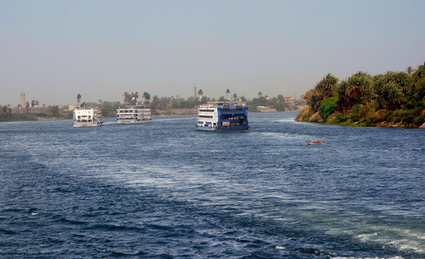A few cruise ships still take a few tourists on lazy trips down the Nile.