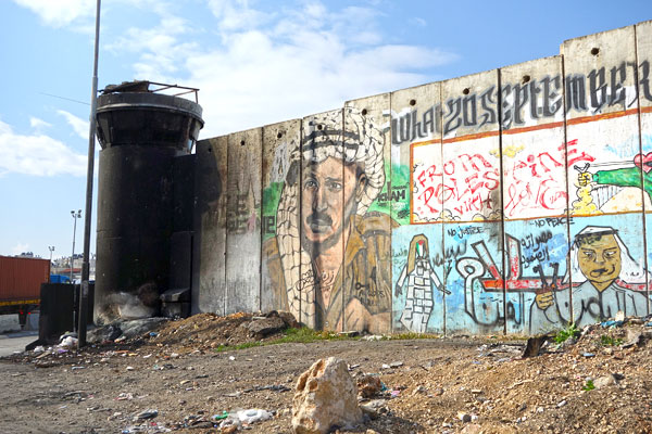 Crossing from the Israeli to Palestinian side, you'll find the wall decorated with political art.