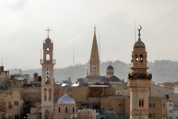 Bethlehems skyline is decorated by steeples and minarets.