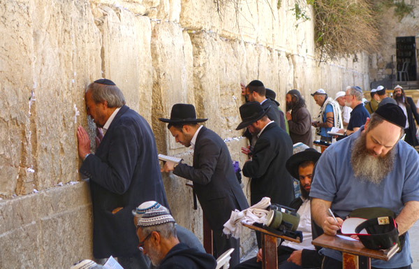 The Western Wall is divided into a men's section and a women's section. Jews place prayers printed on paper into cracks in the wall and bob repeatedly while they pray, as part of their ritual.