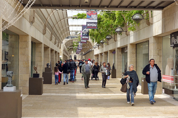 The Green Line was the battlefront in 1967, leaving lots of destruction. After Israel rebuilt the city, one stretch of what was the infamous Green Line is now a long, modern shopping boulevard called the Mamilla Mall.