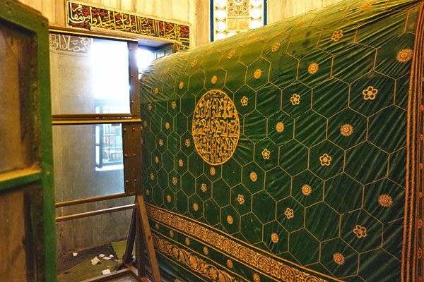 The memorial tomb of Abraham comes with bulletproof glass and barred windows so that his two sons' feuding descendants  Jews and Muslims  can respect his grave.