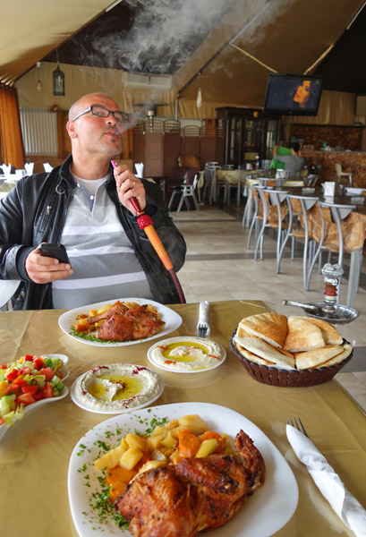 My guide, Husam, took me to Tanoreen, which must be the best restaurant in Nablus, where we enjoyed a fine city view and a local feast — chicken and vegetables cooked in a fire pit...and sweet kunafeh.