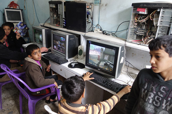 In the very poor refugee camp of Balata kids dont have computers or the Internet at home. But they can spend a few pennies at the Internet shop on the main street. I popped in to see the action. Nearly all the boys were playing violent shoot-em-up computer games. One cute little boy turned to me and said, Shalom. Another, just as cute, turned away from his terminal, looked up at me, and said, F*** you, rich man. Part of me was impressed.