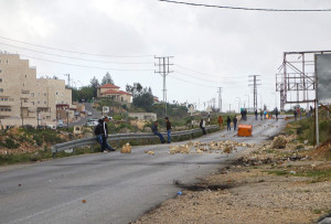 "Coming into Ramallah, a road was closed off with chunks of broken concrete. A few tires were burning in the distance. And a group of teenage boys were throwing rocks at an Israeli police station. It's what some kids do here for a little ""excitement"" after school."