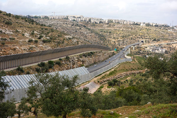Area C also includes Israeli infrastructure — like this fine highway — which cuts through the West Bank connecting Jewish settlements in Palestine with Israel proper. Palestinian license plates are green and Israeli plates are yellow. When times are good all cars are allowed. In troubled times, traffic is yellow plates only.