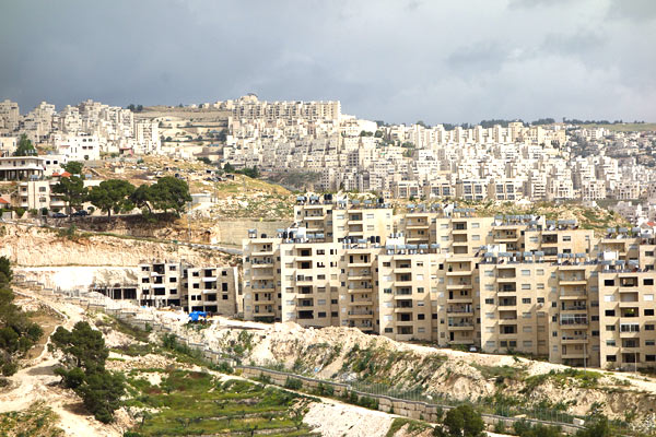 "Many hilltops in the West Bank are now covered with new, planned Israeli communities called ""settlements."" They are connected to Israel by secure, well-built roads."