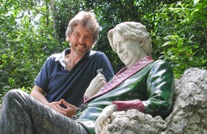 Pat O'Connor, the co-author of Rick Steves' Ireland, poses next to a statue of Oscar Wilde.