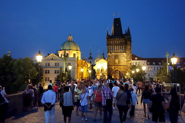 Charles Bridge is a 500-yard stroll over the Vltava River, connecting what many consider Europe's largest castle with a thriving Old Town. Any time of day or night, the stroll comes with fun street music and great people-watching.