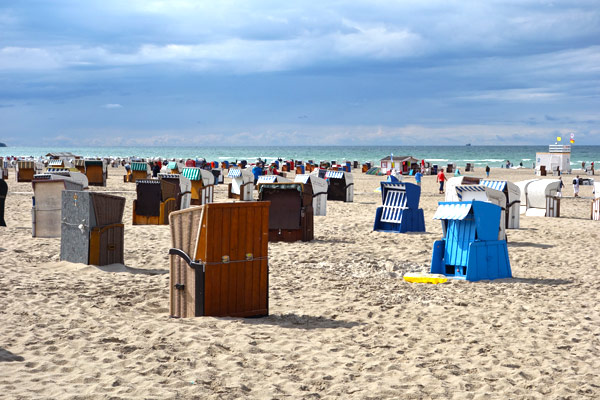 Northern German beach resorts feel a bit like English ones: prepared for bad weather. Here, the beach is decorated with traditional rentable windshield lounge chairs.