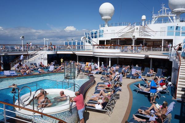 The Emerald Princess' main pool is the social gathering point. A huge screen, used for showing movies, towers above it. Hot water and conversation bubble in the hot tubs at all hours.