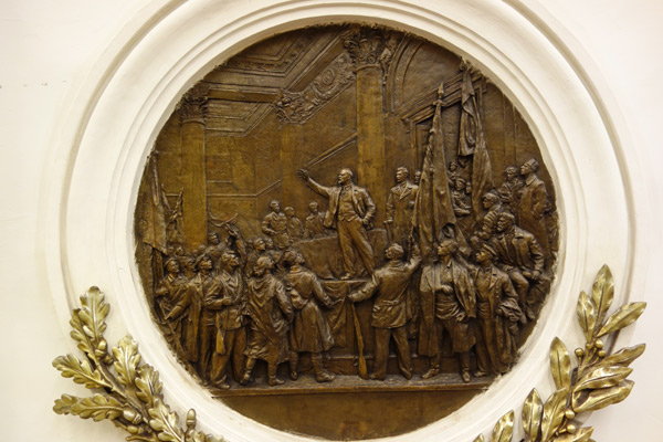As the subway system was a triumph of the former Soviet Union, halls are decorated with Socialist Realism art like this bronze relief. Today, while the hammer and sickle are out of style, these souvenirs of the USSR era are kept as part of the culture's heritage. This particular scene shows Lenin stirring up his masses with his right-hand (hench)man, Joseph Stalin, standing dutifully behind him. After Stalin died in 1953, he was purged from Soviet society, so this is a rare image of him that you can still see in public today.