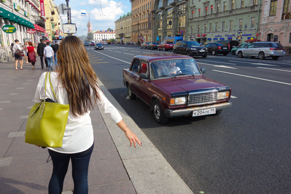 "While probably not advisable for most travelers, locals take full advantage of St. Petersburg's ""unofficial"" taxi system. Getting a ride is like fishing. You look for an old beater car (usually a Soviet-era Lada) driven by a man (usually a Central Asian), and hold out your hand. He'll stop and you negotiate a price. Locals will pay 100 rubles ($3.50) and tourists will be lucky to get a ride for 200 rubles ($7). Hop in and pray you get to the place you agreed to be taken. We did this routinely with our local guides and I got pretty good at spotting beat-up Ladas driven by Uzbeks, saving us piles of walking. While hopping into a Lada on one occasion, I told my guide, ""This is a good system."" He corrected me, saying, ""No, this is a good lack of a system."""