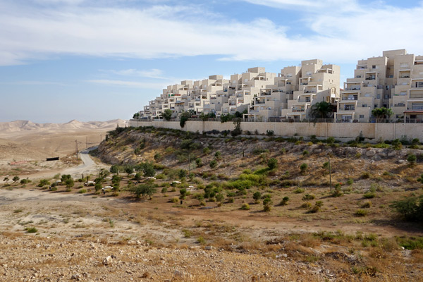 Over half a million Israeli Jews now live in settlements in the West Bank. These planned and secure communities come with all the comforts. And, with Israeli government subsidies for housing and transportation, young Jewish families can afford to live here and commute back to Israel proper. For many, it's a deal too good to refuse.