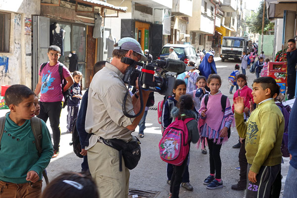 As you can imagine, an American TV crew with a big camera was big news to the kids of Balata. For over 60 years, the United Nations has kept a calming and helpful presence. When the UN-run-and-funded school lets out, the streets flood with children happy to practice their English with a rare tourist venturing into their world.