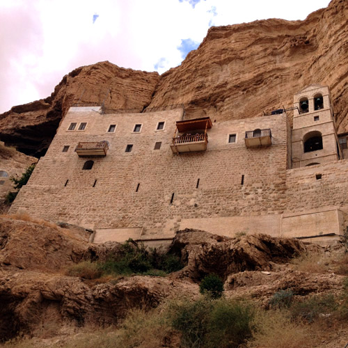 Looking up at this imposing monastery — burrowed into its cliff — it almost seems like a mirage in a parched desert. If you want holy solitude, this is clearly the place.