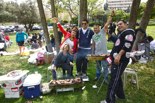 "In nearby Israel, I celebrated that country's 65th birthday with Jewish friends at a city-park BBQ, complete with pork-free ""bacon."""