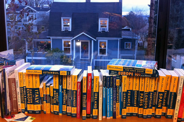 My office-view twofer: Along the windowsill are many of the books we publish; through the window I can see the house where my guidebook staff works.