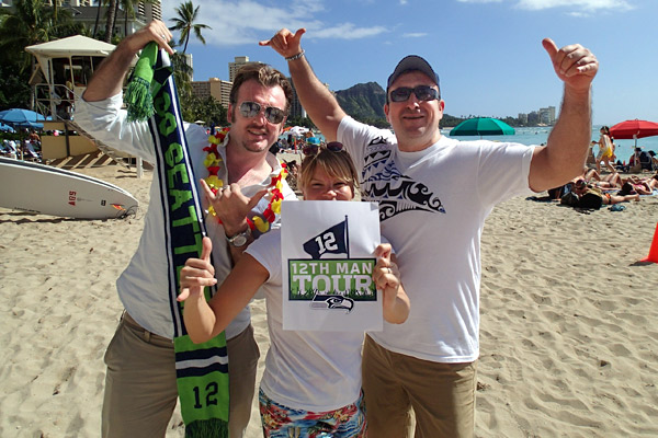 European guides Stephen McPhilemy, Trina Kudlacek, and Mert Taner take their 12th Man pride on holiday to Waikiki Beach, Hawaii.