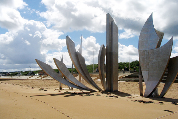 This year marks the 70th anniversary of D-Day, commemorated by this sculpture (Les Braves, by Anilore Banon) on Omaha Beach, honoring the courageous soldiers who landed here.