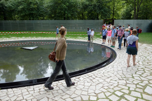 Sightseers visit Berlin's new memorial honoring the Roma and Sinti (Gypsy) victims of Hitler's genocide.