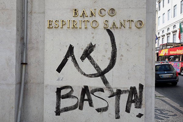 "Basta to Bankers Around the World: Locals are saying ""basta"" (enough) to financial austerity. The discussion these days in Portugal is how the finances of this society are rigged to keep the 99 percent down. Locals sing a sad song I've heard before: The banks, politicians, and economic elites are working together; the working blokes get the shaft; and the rich just get richer."