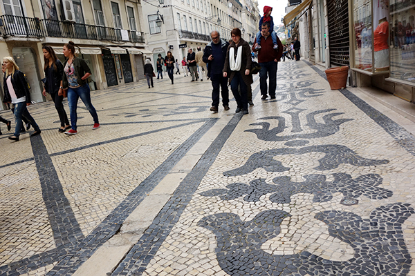 Lisboners Like Their Sidewalks Slippery and Artistic: Lisbon's characteristic limestone and basalt mosaics (calçada) decorating its sidewalks are an icon of the city. But they are slippery and expensive to maintain. With the tough economy, the city government is talking about replacing them with modern pavement. Lisboners are saying no way.