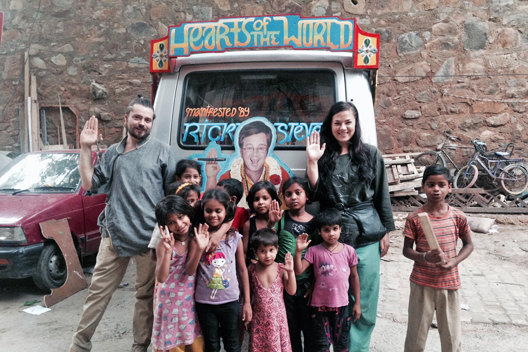 Nicolina and Orien pose with their van alongside Indian children