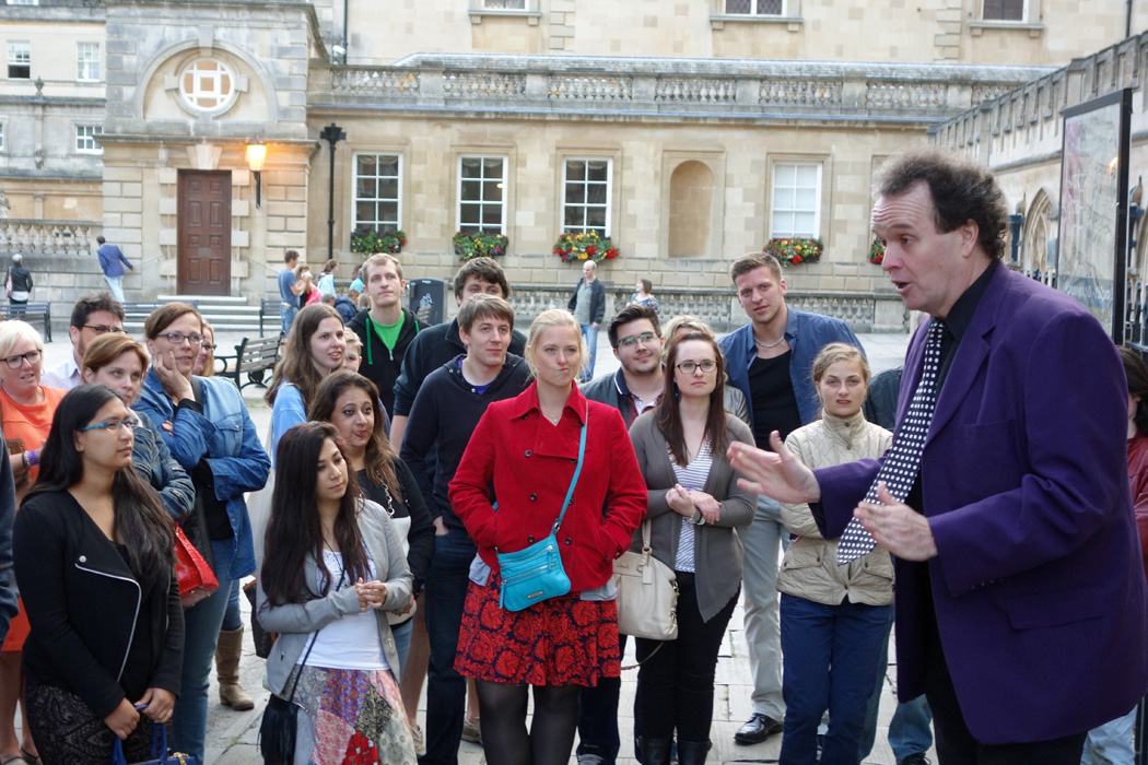 Group watching tour guide in Bath