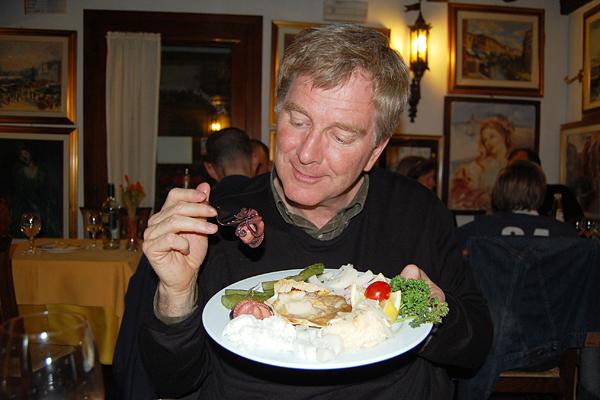 Rick Steves eating octopus
