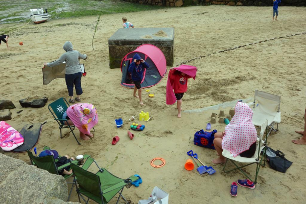 beachgoers with umbrellas