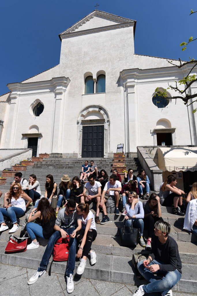 Italians have mastered the art of living. And for Italian teens, that means being the best in the world at simply hanging out on the church steps.