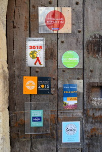 French hoteliers, so proud of what they do, display guidebook endorsements like merit badges.