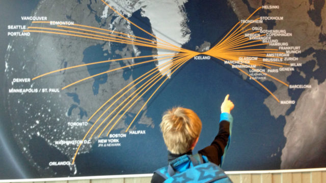 Child pointing at map