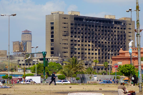Overlooking Tahrir Square, the headquarters of Mubarak's party stands empty and blackened by fire, left as a poignant memorial to the people's accomplishment...and, perhaps, as a warning to future leaders.