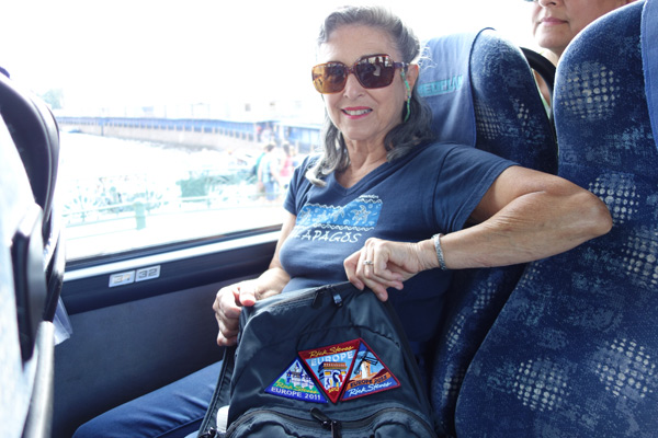 """At Europe Through the Back Door, we produce souvenir patches that many of our tour members enjoy collecting. With this particular tour group, the average number of Rick Steves tours people had taken was five to six. This woman, with """"only"""" three of our patches, was a relative newbie. We're so thankful for the passionate following we have among our tour members. And when I meet these loyal travelers, I'm reminded that they have high expectations for our tours. And I have high expectations for my staff to consistently exceed those high expectations...and they do."""