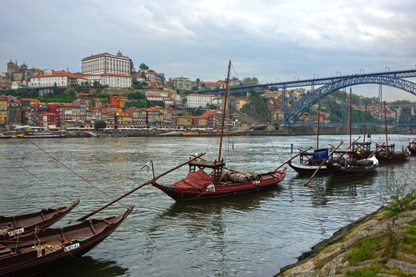 Ribeira View with a Port Buzz Lens   Porto ages happily on the Douro River, along with the most of the world's port wine. The harborfront, called the Ribeira, faces Porto's sister city, Vila Nova de Gaia, just across the river, where traditional boats that hauled the wine to the port lodges for aging and distribution decorate the scene. After visiting a couple of port lodges for a tour and tasting (as is the ritual for visitors to Vila Nova de Gaia), this view across the Douro of Porto's Ribeira looks even better.
