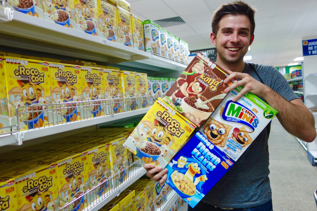 Andy Steves holding four cereal boxes