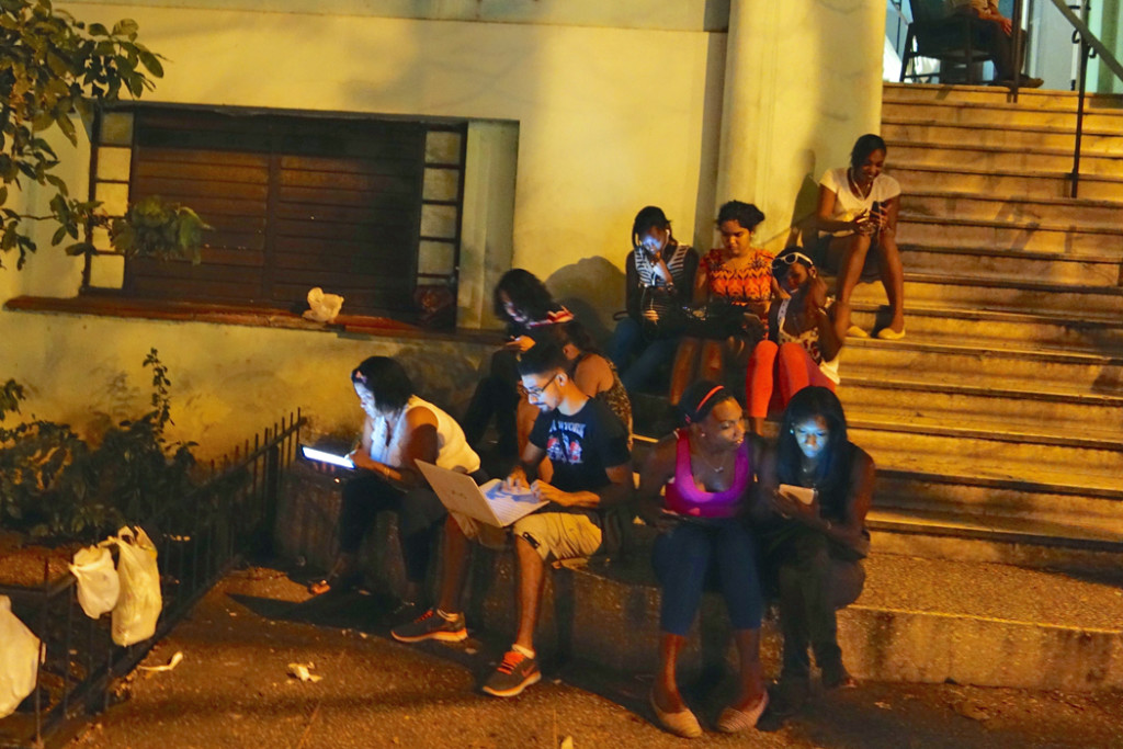 People looking at smart phones