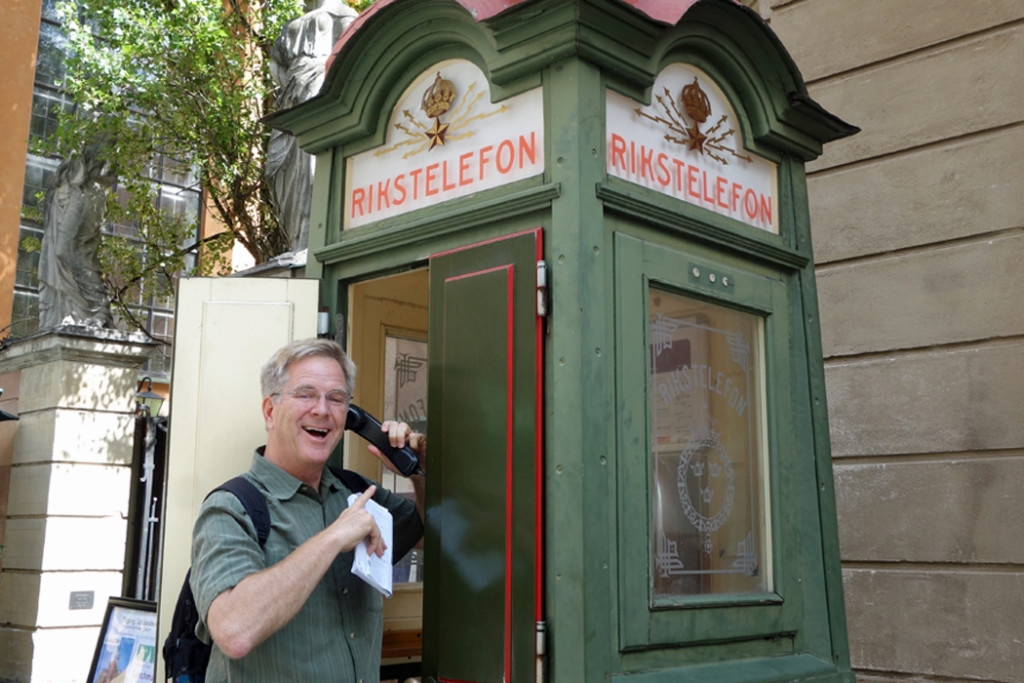 Rick Steves and phone booth in Sweden
