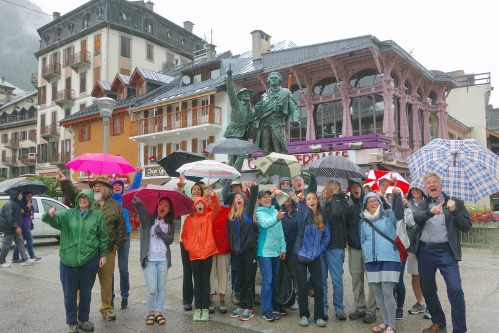 Rick Steves and group with umbrellas