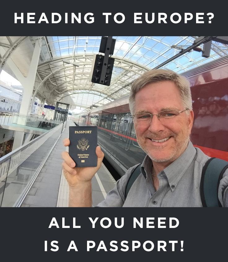 Rick Steves holding a passport
