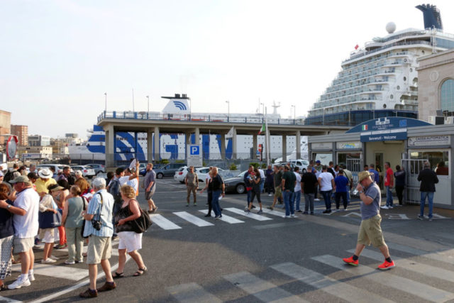 Tourists outside of the port terminal in Naples