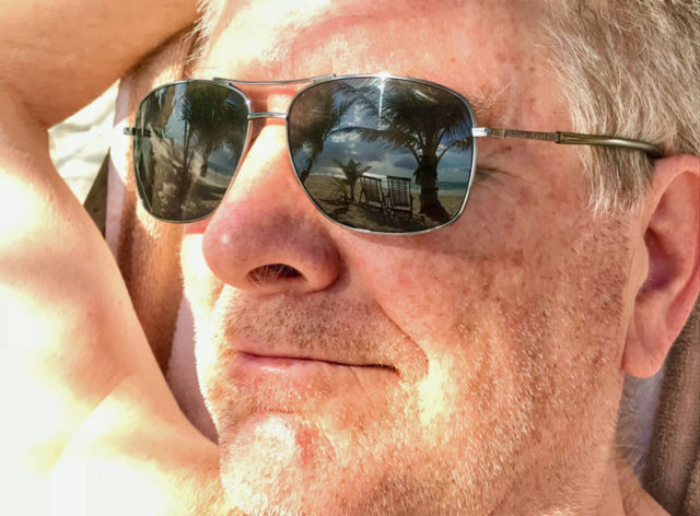 rick steves with beach reflection in sunglasses