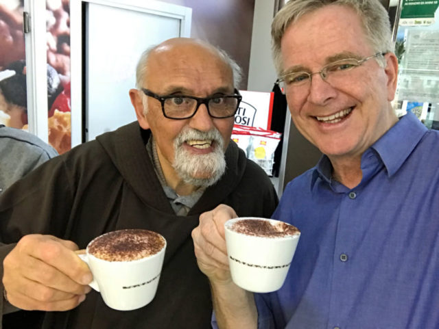 Rick Steves drinking a cappuccino with a monk
