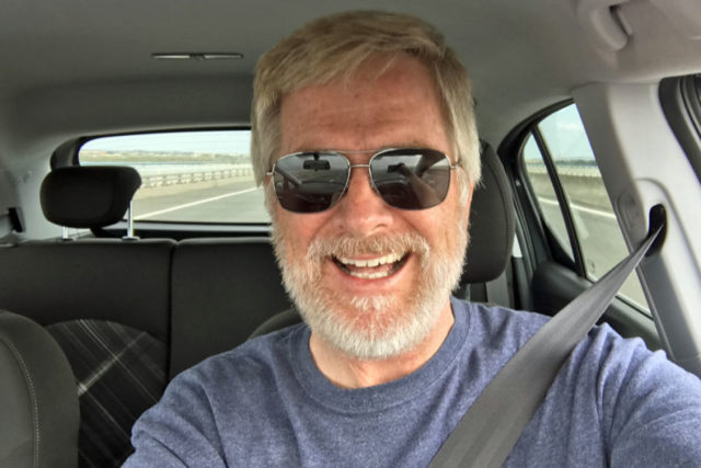 rick steves in a car