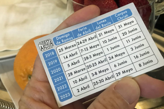 festival dates written in spanish on a small card