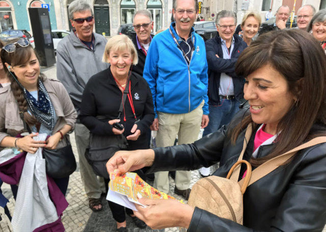 Fatima Bugarin handing out lottery tickets to group